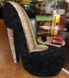 "High Heel Shoe Shaped Chair High Heel Shoe Shaped Upholstered Chair. Black Velvet and Leopard Print Velvet. Measures 40"" tall x 21"" wide x 42"" deep. Condition is very good. No damage. Several Shipping Options Available. Starting Bid $50. Auction Estimate $100 - $200."