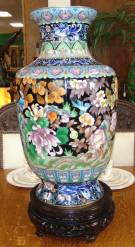 "Large Cloisonne' Vase Beautiful and Large Chinese Cloisonné Vase on Carved Wood Stand. Bright, vivid colors. Circa mid 20th century. Measures 24-1/2"" tall on a 4-3/4"" stand x 14"" wide. 29"" tall total. Overall condition is Excellent. No Damage. Several Shipping Options Available. Starting Bid $100. Auction Estimate $600 - $900."