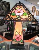 "Tiffany Style Stained Glass Table Lamp Tiffany Style Wonderful 4 sided Stained Glass Table Lamp. Beautiful Floral Pattern. Lights up Top, Bottom or Both. Measures 22"" tall x 13"" wide. Condition is Excellent. No damage. Several Shipping Options Available. Starting bid $50. Auction Estimate $100 - $200."