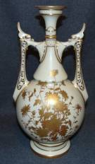 "Ivory Royal Worcester 2 Handled Vase Ivory Royal Worcester 2 Handled Vase. Shape 1071, date code c.1888. Bottom is signed. Measures 14"" tall x 7-1/2"" wide. Overall condition is Excellent. No Damage. Bottom Drilled for lamp. Starting Bid $50. Auction Estimate $60 - $120."