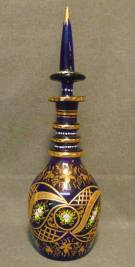 "Vintage Hand Painted Murano Cobalt Glass Decanter Venetian Murano Cobalt Blue Glass Decanter and Stopper. Hand Blown and Painted. Measures 19-1/4"" tall. Condition is very good to excellent. No Damage at all. Starting Bid $50. Auction Estimate $100 - $150."