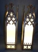 "Pair (2) of Gothic Church Wall Sconces Pair (2) of Gothic Church Wall Sconces. Brass and Glass. Measures 24"" tall x 6"" wide x 6"" deep. Condition is good with minimal wear. No damage. 2 Bulbs. Working Condition. Several Shipping Options Available. Starting Bid $50 for pair. Auction Estimate $150 - $250."